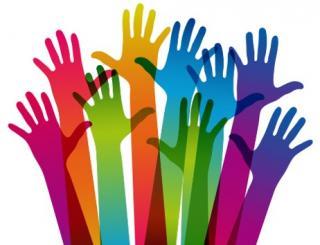Image of many Volunteer hands raised